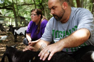 Jeremy Johnson, an Iraq veteran, and his wife, Kelly, tend to the goats at 10 CAN Farm. By learning how to work with the goats, each one which has a different personality, Johnson has learned how to interact with people.
