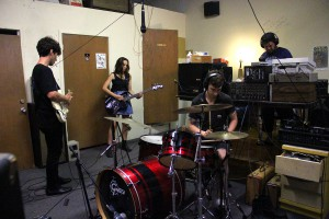 UV-TV records their album in their warehouse studio on May 26, 2015. Rose Vastola, 24, began playing bass a few years ago with her boyfriend and UV-TV guitarist, Ian Bernacett, 25, and 22-year-old drummer, Matt Brotton.