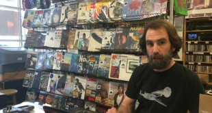 Andrew Schaer works the front desk of Hear Again Music and Movies in downtown Gainesville. The storeowner said he's noticed a rise in the popularity of vinyl records among the younger generation.