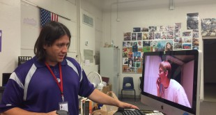 "Tony Malo reviews ""Beyond Thought,"" one of his students' films in his classroom on May 21. His class has just finished their end-of-the-year projects."