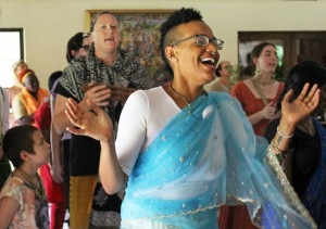 "Christiana Ramirez, a 25-year-old devotee for two months, chants during a kirtan ceremony at the Hare Krishna Temple in Alachua on Sunday, May 21. ""I didn't get through the first round, and I had these tears of blissful joy coming down my face,"" she said. ""And I cannot describe the feeling this day, it's such a strong feeling. And when you feel that, you know there is a God."""