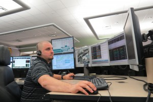 "Matthew Russell, a 29-year-old emergency telecommunicator, responds to a 911 call by sending obtained information to dispatch. ""It's really powerful knowing that someone's life is in your hands,"" he said. ""Just your voice can make a difference whether they make it or not."" Heather Reinblatt/ WUFT News"