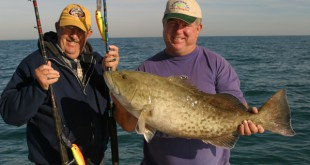 Billy McDaniel (left), Tommy Hines (right) catch a gag grouper at Cedar Key, trolling in 50 feet of water.