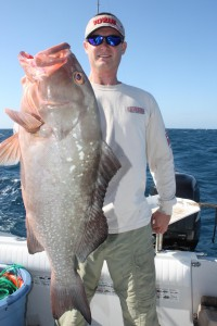"Jimmy Nelson, owner and host of television show Extreme Fishing Adventures, shows off a red grouper caught during the filming of an episode out of Key West, Fla., in January 2011. ""I wanted to be able to fish for free because it was too expensive, and I wanted to see the world,"" said Nelson, 36-year-old Dunnellon resident."