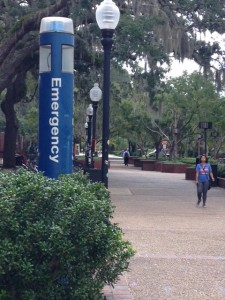 A student walks by an emergency phone station at the Hub. UF was chosen by the VTV Family Outreach Foundation as a model for campus safety in the nation.