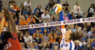 Florida's Živa Recek goes for a spike during the first set against St. John's.