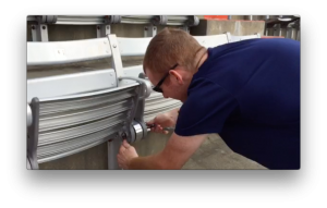 A screen shot from a video showing the replacement part being installed in a seat at Ben Hill Griffin Stadium.