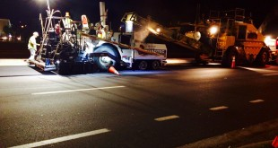 Construction workers work late into the night on Monday as they place the final layer of asphalt onto Southwest 34th Street. Gainesville residents should expect lane closures until at least Friday, Sept. 25, as the road is restored.