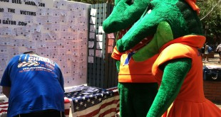 "UF School mascots Albert and Alberta join in writing a good deed at the Lubavitch-Chabad ""Good Deed Mitzvah Marathon"" on Friday. The two gators pledged to help a friend that day."