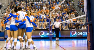 From left to right: Carli Snyder (4) Alex Holston (3) Nikki O'Rourke (20) Rhamat Alhassan (1) Mackenzie Dagostino (covered) and Gabby Mallette (back) celebrate scoring after a long rally during the second set against FSU. (photo by Samuel Navarro)
