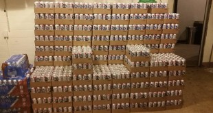 "Dubbed the ""Aluminum Throne,"" Wooly manager Audrey Dingeman said her compound alone bought 500 cases of PBR tallboys. (WUFT News / Jake Black)"