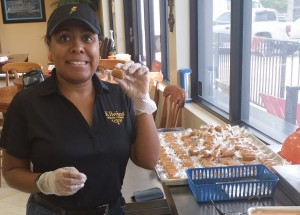 Ashley Williams, 34, cuts, packages and weighs caramel chews at Kilwins Jacksonville. Williams is one of two employees with a disability who works at Kilwins Jacksonville.