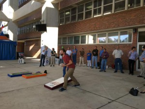 John Houder tosses a bean bag in the final round of today's Cornhole Tournament outside Ben Hill Griffin Stadium. The event saw 84 contractors and members of UF Planning Construction and Design compete in a bracket-style tournament. Oscar Bergeron-Oakes / WUFT News
