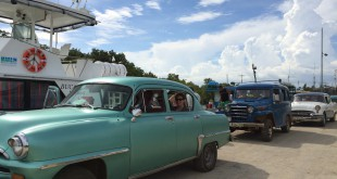 "A group of UF students studying abroad in Cuba this summer. After returning from the Isle of Youth, their bus back to Havana was no where to be found, so the professors arranged a caravan of classic cars to drive the students back to the capital. ""Couldn't have planned that one better and we'll be taking the cars next year instead of the bus,"" professor Donald Behringer said. Photo courtesy of Donald Behringer."