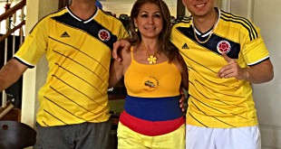 Diego Castillo and his parents pose for a photo after a Colombia game during the 2014 FIFA World Cup that resulted in a win.