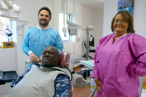 Dr. Ivanov (left) poses with a patient and his dental hygenist. The dental clinic aims to provide low-cost dental care and services to the local community and Alachua County residents. Photo courtesy of the Alachia County Department of Health.