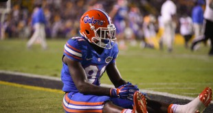 Florida wide receiver Antonio Callaway sits on the field after missing a catch in the final seconds of the game that would have given the gators a first down.