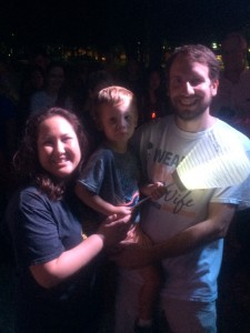"Diana Fillipps (left) poses with her son, Bryce, and husband, Dave, at the helm of the Light the Night procession Friday. ""I had my son and yet at the same time I was going through cancer. It was something I never expected as a new mother and very bittersweet,"" Fillipps said. Zee Krstic / WUFT News"