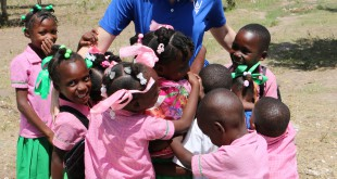Kristen (I'm waiting on a last name) hangs out with children from the Pwoje Espwa Sud Orphanage outside of Les Cayes, Haiti. aqUV donates purifiers to their partner organizations in Haiti: Alpha Omega Medical Ministries, Free the Kids, and Consolation Center Haiti.