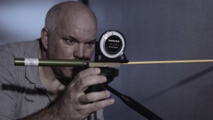 Investigator Marc Trahan uses trajectory rods to show the path of a projectile during a previous training video for the Gainesville Police Department. Photo courtesy of Gainesville Police Department