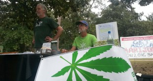 Harry Patterson (left) and Jim Funk (right) both show their support for Floridians for Freedom. Funk said that cannabis has been used as a medicine for over  3,000 years and treats over 100 different conditions and symptoms.