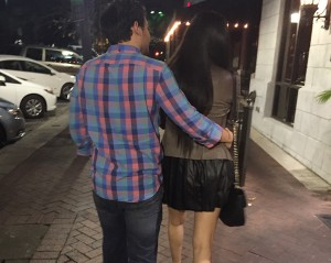 """Gabriela Moncada walks with her boyfriend Michael as they head to dinner. """"It's crazy how some people think it's a red flag when women in their late twenties and thirties don't have a ring on their finger,"""" she said."""