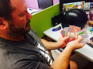 Chuck Call, the chief financial officer for Atheris Games, shows off some of the cards for his company's newly funded game while sitting in the Gator Hatchery. The game, Cul-De-Sac Conquest, fundraised $10,000 in 52 hours. NEEDS CREDIT