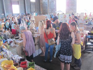 Gainesville residents peruse the GLAM Craft Show in 2014, back when it was held at the University Air Center. Artists and crafters came together to form their own pop up shops and showcase their work. (Photo credit to Kim Kruse)