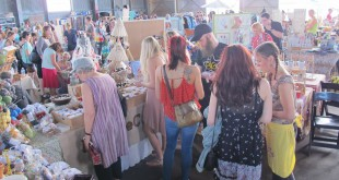 Gainesville residents peruse the GLAM Craft Show in 2014, back when it was held at the University Air Center. Artists and crafters came together to form their own pop up shops and showcase their work.  Photo courtesy of Kim Kruse