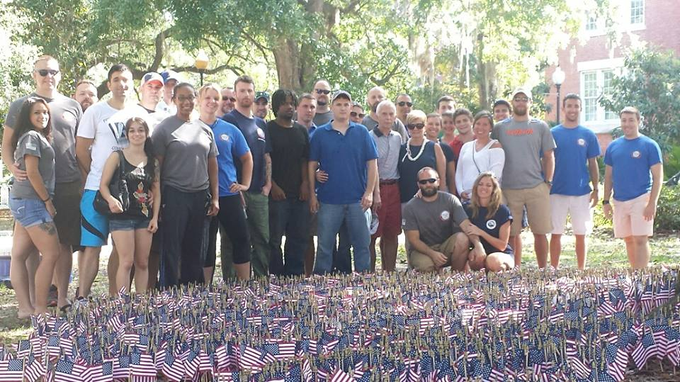"""Veterans and students gather for a photo on Memorial Day 2015. """"The training that we do, we have to recognize that someone is struggling,"""" said Cobb, who joined the Collegiate Veterans Success Center's staff when he began his studies at UF. """"A lot of these students have all been in combat zones, a whole different light of experiences that an average college student isn't exposed to, and hopefully will never be."""" Photo courtesy of Randall Martin."""