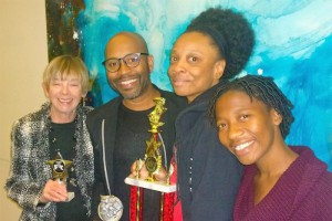 """Some of the cast and crew of """"Tshepang"""" after their wins at the Florida Theatre Conference. Left to Right: Jan Cohen, Steven Butler, Jamaili Tyler and Mandisa Harrhoff. Photo courtesy of Steven Butler."""