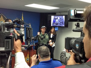 Pasco County Sheriff's Office deputy Kristina Perez, demonstrates how her body camera can be worn on December 11, 2014, during a press conference. Photo courtesy of Pasco County Sheriff's Office