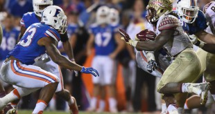 Florida State running back Dalvin Cook prepares to stiff-arm Florida linebacker Jeremi Powell during the teams' 2015 game. When they face off again Saturday, the Gators will be looking for their first win over the Seminoles since the 2012-13 season. (File/WUFT News)