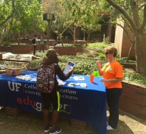 Penny Cox, graduate coordinator of special education at UF, speaks to a student about the new graduate certificate for disabilities in society while tabling an event in Turlington Plaza on Monday. The new program will debut in the spring semester of 2016.