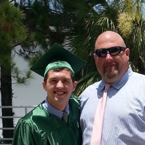 "Rogers (left) poses with Coach Jeffery Parker at Eastside's graduation ceremony on June 1, 2015. ""Landon lived with his life with determination and decision. It was very apparent in the way he lived his life,"" Parker said. Photo courtesy of Jeffery Parker."