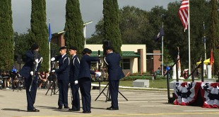 The Billy Mitchell Drill Team performs its routine near the end of the day's ceremony. Members of the University of Florida's Air Force ROTC program, the drill team were heavily applauded upon completing their complicated routine of gun flips and tosses.