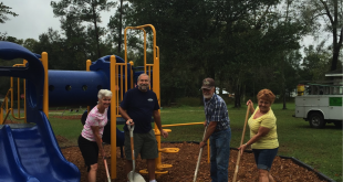Hampton Mayor Gene Brannick and community volunteers help lay the new mulch down at City Park. The money for the project came from the recently awarded City Catalyst Grant. (Photo courtesy  of Mary Lou Hildreth)