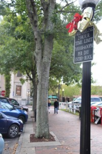 """A two-hour parking sign on SE 1st Street in downtown Gainesville denotes how long one is allowed to park. """"There's a lot of business downtown, and the idea is to keep the traffic moving and to keep spaces open,"""" said Andrew Schwich, parking operations attendant with the City of Gainesville Parking Operations. Griffin Horvath/WUFT New"""