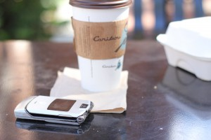 "Alex Cervinka gave up smartphones over a year ago. His Motorola Razr sits dead next to his cup of coffee, ""It's been dead for like two days,"" said Cervinka. Destiny Johnson/WUFT News"