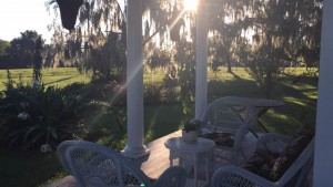 The south porch of the Wood home in Evinston, Florida, looks out into the backyard where weddings have been held and children have grown up.