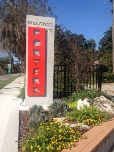 One of the 8-foot gateways that welcomes residents and visitors into the Porters community. The sidewalk and the gateways were completed in August, and residents have noticed major improvements in the area. Kristine Janata/WUFT News