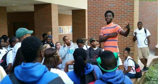 "Rood Emmanuel, a UF sophomore, gives a campus tour to a group of Deerfield Beach High School students last Spring. Jermaine Pinkney, or ""pops,"" asked Emmanuel to give a tour for another group of students after his Kappa League chapter missed their scheduled UF tour that same semester. ""He was very inspirational,"" Pinkney said.  (Edward Junior III)"