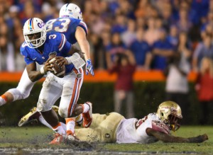 Florida quarteback Treon Harris escapes a defender during the November 2015 game against Florida State University. (File/ WUFT News)
