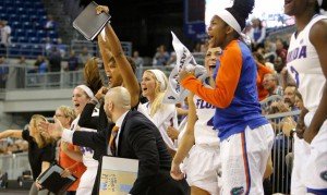 The UF women's basketball team celebrates after beating FSU Nov. 16 in the O'Connell Center. The new 24-second shot clock rule would benefit the Gators if passed. Lorraine Hoffmann / UAA Communications.