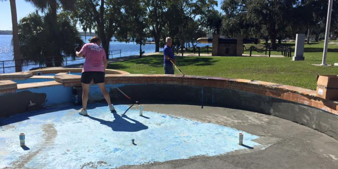 Douglas Van Horn and his wife Victoria work on renovating one of the Riverfront Fountains basins. Photo courtesy of Alex Sharp.