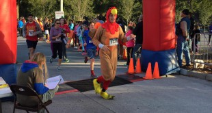 Runners cross the finish line at the 19th annual Turkey Trot in 2014—wearing everything from running shoes to turkey costumes. Over 2,000 runners registered for the race. Photo courtesy of the Frank DeLuca YMCA