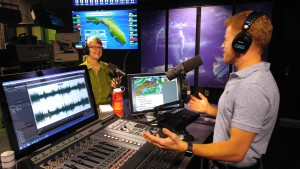 Environmental journalist Cynthia Barnett, Hearst Visiting Professional in the UF College of Journalism and Communications, with her ever-present orange Nalgene reusable water bottle, doing a radio show on weather and climate change with UF chief meteorologist Jeff Huffman. Photo courtesy of Ken Pemberton.