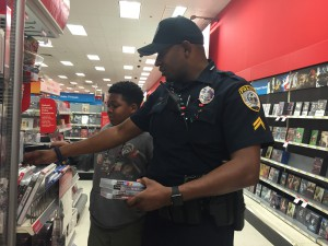 Corporal Christopher Cardwell sorts through video games with Manhattan McFadden. Caitlin Franz / WUFT News