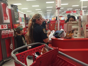 Officer Erika Benson and Alyssa Hawley check out with all of her new purchases. Caitlin Franz / WUFT