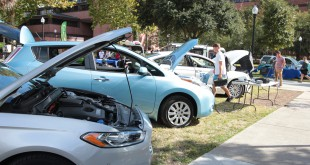 The Sustainable Transportation Fair is one of the UF Office of Sustainability's many initiatives to reduce the university's carbon footprint and combat climate change. The vehicles are part of the electric vehicle display, which included a plug-in Ford Fusion, a Nissan Leaf, a Tesla, and E-Ride utility vehicle, a Green van and a hybrid car that is part of the Zipcar fleet. Photo courtesy of Allison Vitt.